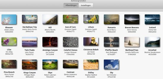 Linux Mint bevat een aantal aardige foto's die u als bureaubladachtergrond kunt gebruiken. U ziet ze hier op deze schermafbeelding. U kunt ook een eigen foto inzetten.